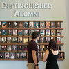 JOED VIERA/STAFF PHOTOGRAPHER-Lockport, NY-Alumni Dylan Nuhn  and Angelina Wronski look at a wall Lockport High School's  Distinguished Alumni at the reception on Thursday, August, 21st.