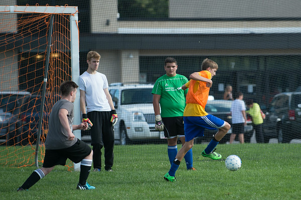 JOED VIERA/STAFF PHOTOGRAPHER-Lockport, NY-Lockport's Boys Varsity Soccer team runs a drill during practice on Monday, August 18th.