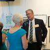 JOED VIERA/STAFF PHOTOGRAPHER-Lockport, NY-Sandy Weber and David Shambach speak at Lockport High School's Distinguished Alumni reception on Thursday, August, 21st.