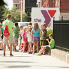 JOED VIERA/STAFF PHOTOGRAPHER-Lockport, NY-Kids wait outside of the YMCA before taking a walk during the YMCA's day camp on Tuesday, August, 26th.