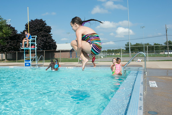 JOED VIERA/STAFF PHOTOGRAPHER-Lockport, NY-Elizabeth Truscio 10  jumps into the Rotary Club Pool on Friday, August, 22nd.