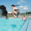 JOED VIERA/STAFF PHOTOGRAPHER-Lockport, NY-Elizabeth Truscio 10  jumps into the Rotary Club Pool on Friday, August, 22nd.