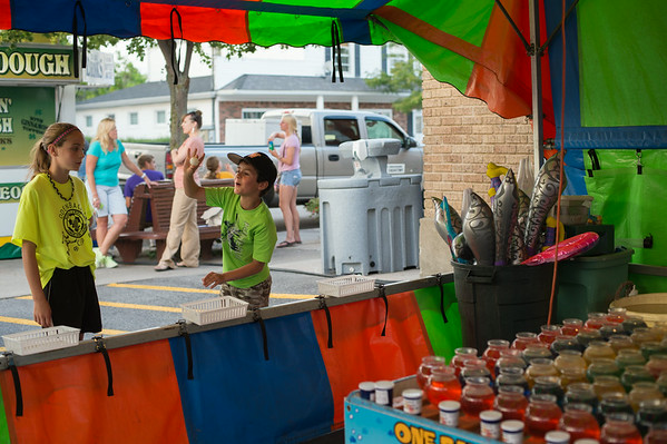 JOED VIERA/STAFF PHOTOGRAPHER-Wilson, NY-Kassidy and Casey Sidote attempt to win a goldfish at the fair  on Thursday, August, 21st.