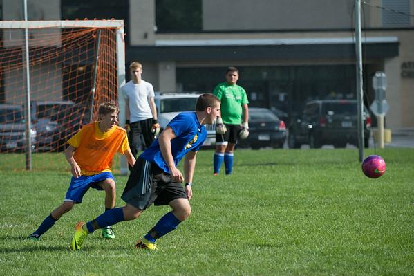 JOED VIERA/STAFF PHOTOGRAPHER-Lockport, NY-Lockport's Boys Varsity Soccer team runs a drill during practice on Monday, August 18th.