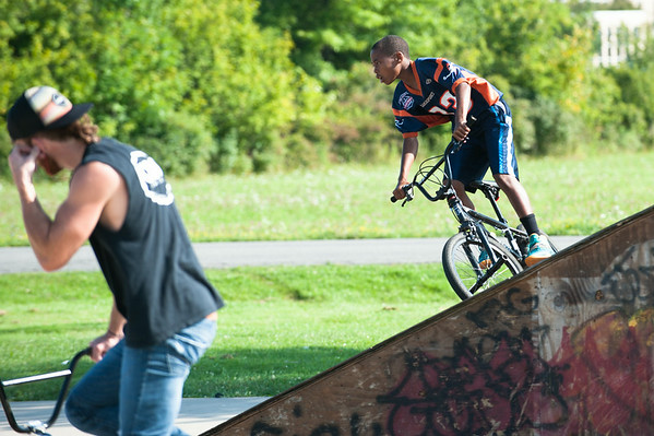 JOED VIERA/STAFF PHOTOGRAPHER-Lockport, NY-Travis Farnsworth and Mario Douglass 12 rides his bike at the skate park on Friday, August, 22nd.