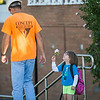 JOED VIERA/STAFF PHOTOGRAPHER-Lockport, NY-Roy B. Kelley Elemantary Kindergartner Annaliesse Bosso shows a construction worker a flower during the first day of school on Wednesday, September,3rd.