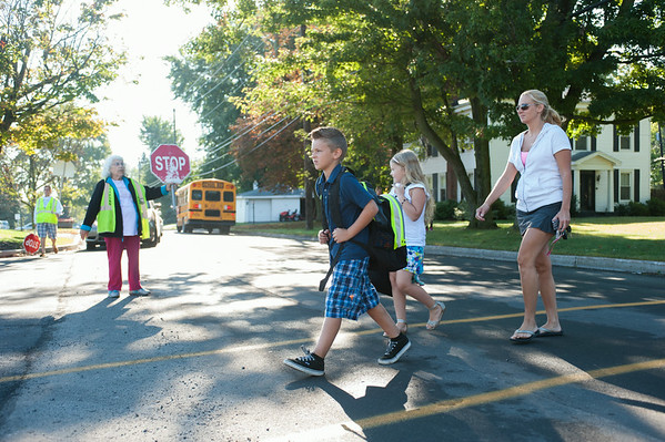 JOED VIERA/STAFF PHOTOGRAPHER-Lockport, NY-Lisa Pickard crosses the street with her children Nicholas and Alexadra before their first day of school at Roy B Kelley Elementary School on Wednesday, September,3rd.