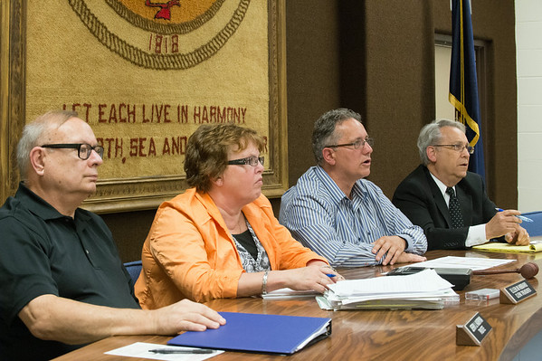 JOED VIERA/STAFF PHOTOGRAPHER-Wilson, NY-The Village of Wilson board of trustees answer questions at Wilson's Town Hall during a meeting before Tuesday's vote on dissolution on Thursday, August, 21st.