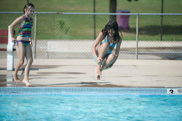 JOED VIERA/STAFF PHOTOGRAPHER-Lockport, NY-Elizabeth Truscio 10 watches as her friend Sara Melendez  11 jumps into the Rotary Club Pool on Friday, August, 22nd.
