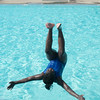 JOED VIERA/STAFF PHOTOGRAPHER-Lockport, NY-Carmella Hill 9 does a backflip into the Rotary Club Pool on Friday, August, 22nd.