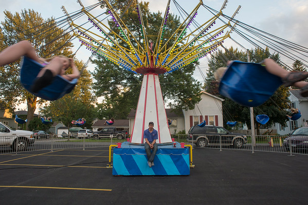 JOED VIERA/STAFF PHOTOGRAPHER-Wilson, NY-An operater watches kids have fun on his ride at the fair on Thursday, August, 21st.