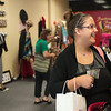 JOED VIERA/STAFF PHOTOGRAPHER-Lockport, NY-Selena Torres puts her change away after shopping at Bling on Wednesday, August, 27th.