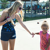 JOED VIERA/STAFF PHOTOGRAPHER-Lockport, NY-Lifeguard Erika Badach holds hands with Sierra Volmy 5 at the Rotary Club Pool on Friday, August, 22nd.