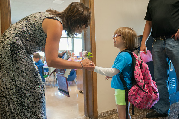 JOED VIERA/STAFF PHOTOGRAPHER-Lockport, NY-Roy B. Kelley Elemantary Kindergartner Annaliesse Bosso gives her teacher Amanda Criddle a flower during the first day of school on Wednesday, September,3rd.