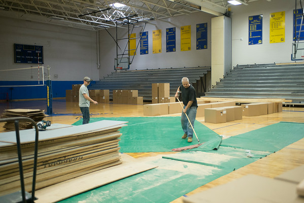 JOED VIERA/STAFF PHOTOGRAPHER-Lockport, NY-A crew cleans up the Lockport High School gym after commencing the installation of new bleachers on Friday, August, 22nd.