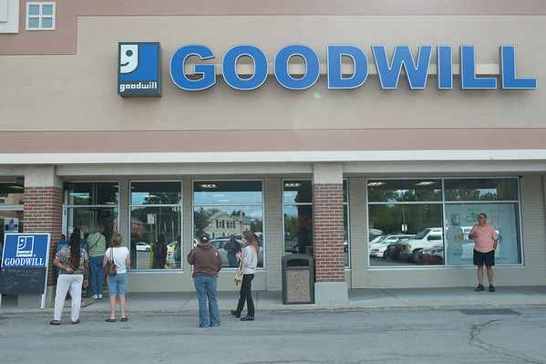 JOED VIERA/STAFF PHOTOGRAPHER-Lockport, NY-Shoppers line up outside of the Goodwill for their grand Re-Opening on Thursday, August, 28th.