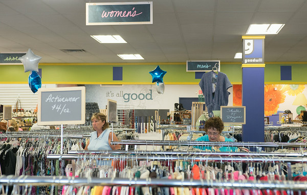 JOED VIERA/STAFF PHOTOGRAPHER-Lockport, NY-Shoppers browse the aisles of Goodwill during their grand re-opening on Thursday, August, 28th.