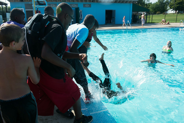 JOED VIERA/STAFF PHOTOGRAPHER-Lockport, NY-A group of kids throw a freind into the Rotary Club Pool on Friday, August, 22nd.