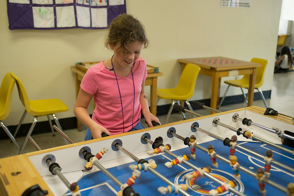 JOED VIERA/STAFF PHOTOGRAPHER-Lockport, NY-Chloe Glor plays foosball at the YMCA during the YMCA's Daycamp on Tuesday, August, 26th.