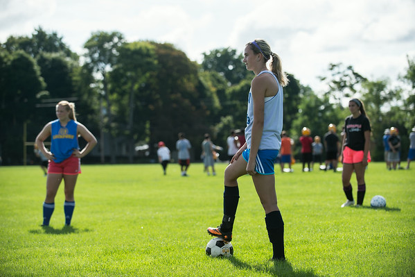 JOED VIERA/STAFF PHOTOGRAPHER-Lockport, NY-Lockport's Girl Varsity Soccer team listen to coach during practice on Monday, August 18th.