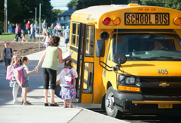 JOED VIERA/STAFF PHOTOGRAPHER-Lockport, NY-A Roy B. Kelley students get off the bus for their first day of school at Roy B Kelley Elementary School on Wednesday, September,3rd.