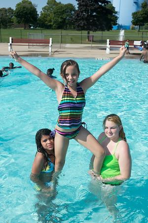 JOED VIERA/STAFF PHOTOGRAPHER-Lockport, NY-Sara Melendez  11 and Kayleigh Pratt 13 hold up Elizabeth Truscio 10 in the Rotary Club Pool on Friday, August, 22nd.