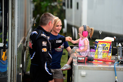 Jason Hughes receives a fist pump from his daughter while his wife looks on.