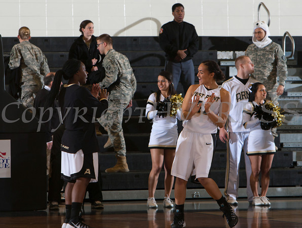 Army Forward Brianna Johnson (41) is introduced prior to their Patriot League Tournament Semifinal game against the American University Eagles at the United States Military Academy's Christl Arena in West Point, NY on Monday, March 10, 2014. Army defeated American, 68-55, to advance to the finals. Hudson Valley Press/CHUCK STEWART, JR.