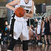 Army Forward Olivia Schretzman (12) handles the ball during their Patriot League Tournament Semifinal game against American at the United States Military Academy's Christl Arena in West Point, NY on Monday, March 10, 2014. Army defeated American, 68-55, to advance to the finals. Hudson Valley Press/CHUCK STEWART, JR.