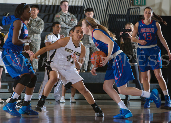 Army Forward Brianna Johnson (41) defends American's Jen Dumiak (3) during their Patriot League Tournament Semifinal game at the United States Military Academy's Christl Arena in West Point, NY on Monday, March 10, 2014. Army defeated American, 68-55, to advance to the finals. Hudson Valley Press/CHUCK STEWART, JR.