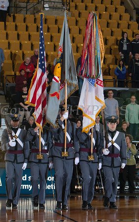 The Army Colour Guard enters Chrisl Arena where Army hosted the Patriot League Tournament Semifinal game against the American University Eagles at the United States Military Academy's Christl Arena in West Point, NY on Monday, March 10, 2014. Army defeated American, 68-55, to advance to the finals. Hudson Valley Press/CHUCK STEWART, JR.