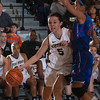 Army Guard Kelsey Minato (5) drives to the basket as Alexis Dobbs (21) defends. The Black Knight's defeated the American University Eagles 68-55 in their Patriot League Tournament Semifinal game at the United States Military Academy's Christl Arena in West Point, NY on Monday, March 10, 2014. Hudson Valley Press/CHUCK STEWART, JR.