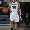 Army Guard Jordan Elliott (30) handles the ball during their Patriot League Tournament Semifinal game against American at the United States Military Academy's Christl Arena in West Point, NY on Monday, March 10, 2014. Army defeated American, 68-55, to advance to the finals. Hudson Valley Press/CHUCK STEWART, JR.