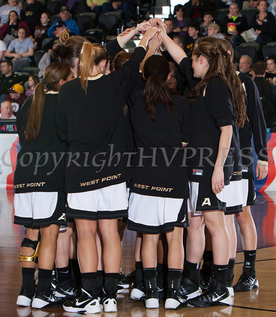 The Army Black Knight's huddle up prior to their Patriot League Tournament Semifinal game against the American University Eagles at the United States Military Academy's Christl Arena in West Point, NY on Monday, March 10, 2014. Army defeated American, 68-55, to advance to the finals. Hudson Valley Press/CHUCK STEWART, JR.