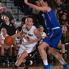 Army Guard Kelsey Minato (5) drives to the basket as the Black Knight's defeated the American University Eagles 68-55 in their Patriot League Tournament Semifinal game at the United States Military Academy's Christl Arena in West Point, NY on Monday, March 10, 2014. Hudson Valley Press/CHUCK STEWART, JR.