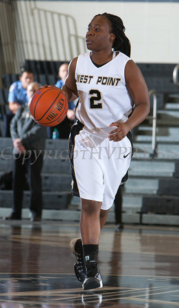 Army Guard Brigette Ocran (2) handles the ball during their Patriot League Tournament Semifinal game against American at the United States Military Academy's Christl Arena in West Point, NY on Monday, March 10, 2014. Army defeated American, 68-55, to advance to the finals. Hudson Valley Press/CHUCK STEWART, JR.