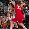 Army Forward Aimee Oertner (33) drives to the basket as Boston's Meghan Green (33) defends during the Patriot League Tournament Quarterfinal game at the United States Military Academy's Christl Arena in West Point, NY on Thursday, March 6, 2014. Army defeated Boston 49-45. Hudson Valley Press/CHUCK STEWART, JR.
