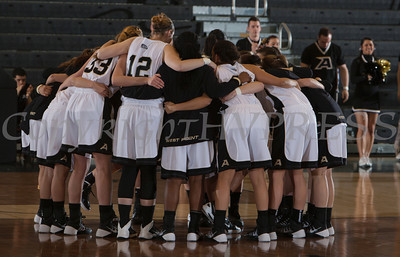 Army playres huddle up prior to taking on Boston in the Patriot League Tournament Quarterfinal game at the United States Military Academy's Christl Arena in West Point, NY on Thursday, March 6, 2014. Army defeated Boston 49-45. Hudson Valley Press/CHUCK STEWART, JR.