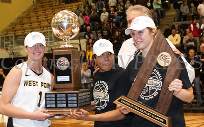 Army captains Jen Hazlett, Jordan Elliott and Olivia Schretman, along with head coach Dave Magarity accept the Patriot League Championship trophy after they defeated the Holy Cross Crusaders 68-58 at the United States Military Academy's Christl Arena in West Point, NY on Saturday, March 15, 2014. Hudson Valley Press/CHUCK STEWART, JR.