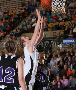 Army Forward Olivia Schretzman (12) drives to the basket as the Black Knight's defeated the Holy Cross Crusaders 68-58 in the Patriot League Championship game at the United States Military Academy's Christl Arena in West Point, NY on Saturday, March 15, 2014. Hudson Valley Press/CHUCK STEWART, JR.