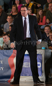 Holy Cross head coach Bill Gibbons looks on as the Black Knight's defeated the Holy Cross Crusaders 68-58 in the Patriot League Championship game at the United States Military Academy's Christl Arena in West Point, NY on Saturday, March 15, 2014. Hudson Valley Press/CHUCK STEWART, JR.