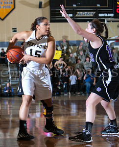 Army Guard Krishawn Tillett (15) is guarded by Madelyn Ganser (15) as the Black Knight's defeated the Holy Cross Crusaders 68-58 in the Patriot League Championship game at the United States Military Academy's Christl Arena in West Point, NY on Saturday, March 15, 2014. Hudson Valley Press/CHUCK STEWART, JR.