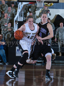 Army Forward Olivia Schretzman (12) pushes past Kelly Hamner (1) as the Black Knight's defeated the Holy Cross Crusaders 68-58 in the Patriot League Championship game at the United States Military Academy's Christl Arena in West Point, NY on Saturday, March 15, 2014. Hudson Valley Press/CHUCK STEWART, JR.