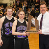 Holy Cross players Christine Ganser (34), Alex Smith (22) and head coach Bill Gibbons accept the Runner-Up trophy after the Army Black Knight's defeated the Holy Cross Crusaders 68-58 in the Patriot League Championship game at the United States Military Academy's Christl Arena in West Point, NY on Saturday, March 15, 2014. Hudson Valley Press/CHUCK STEWART, JR.