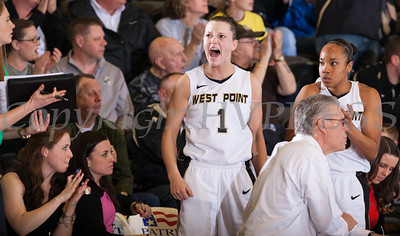 Army Forward Jen Hazlett (1) and Jordan Elliott (30) react to a play during the Patriot League Championship game at the United States Military Academy's Christl Arena in West Point, NY on Saturday, March 15, 2014. Army defeated Holy Cross 68-58.  Hudson Valley Press/CHUCK STEWART, JR.