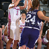 Army Guard Jen Hazlett (1) puts up a shot as Kate Gillespie (24) defends. The Black Knight's were defeated by the Holy Cross Crusaders 92-85 at the United States Military Academy's Christl Arena in West Point, NY on Wednesday, February 12, 2014. Hudson Valley Press/CHUCK STEWART, JR.