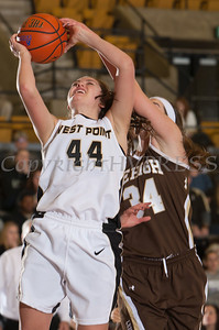 Army Forward Allie Setter (44) drives to the basket past Kerry Kinek (34). The Black Knight's defeated the Lehigh Mountain Hawks 74-63 at the United States Military Academy's Christl Arena in West Point, NY on Wednesday, January 8, 2014. Hudson Valley Press/CHUCK STEWART, JR.