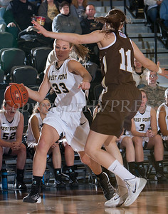 Army Forward Aimee Oertner (33) drives the baseline as Alexandra Yantzi (11) defends. The Black Knight's defeated the Lehigh Mountain Hawks 74-63 at the United States Military Academy's Christl Arena in West Point, NY on Wednesday, January 8, 2014. Hudson Valley Press/CHUCK STEWART, JR.