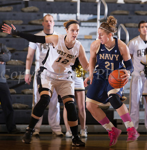 Army Forward Olivia Schretzman (12) defends Navy's Jade Geif (21) as the Black Knight's defeated the Navy Midshipmen 54-48 at the United States Military Academy's Christl Arena in West Point, NY on Saturday, February 8, 2014. Hudson Valley Press/CHUCK STEWART, JR.