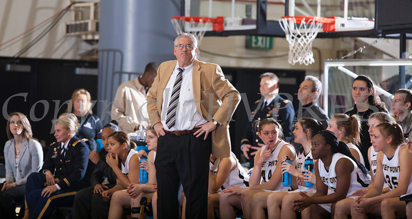 Army head coach Dave Magarity watches as the Black Knight's defeated the Navy Midshipmen 54-48 at the United States Military Academy's Christl Arena in West Point, NY on Saturday, February 8, 2014. Hudson Valley Press/CHUCK STEWART, JR.